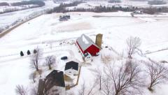 Aerial tour over snowy rural Wisconsin homes in Winter Stock Footage
