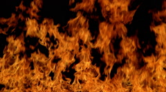 Flames leaping toward top of black frame Stock Footage