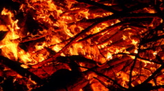 Pile of stacked branches burning at night Stock Footage