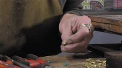 a jeweler creates a bracelet - stock footage