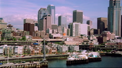 Low flight along Seattle's waterfront. Shot in 2000. Stock Footage