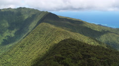 Flight along forested spine of a ridgeline in The Valleys area, Hawaii. Shot in Stock Footage