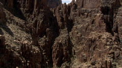 Flying through notch in rocks along Arizona's Little Colorado River Gorge Stock Footage