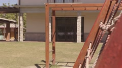 Boy swinging a crossed monkey bars at a park Stock Footage