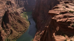 Looking down onto Colorado River flowing through deep canyon - stock footage