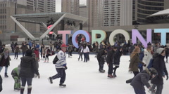 People skating at outdoor rink in front of city hall in Toronto. 4K Stock Footage