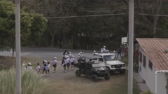 School children in uniform, on a field trip walking by a street Stock Footage