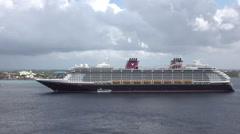 Grand Cayman Island Caribbean Disney ship off coast HD Stock Footage