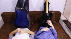Creative happy couple playing guitar Stock Footage