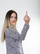 Sporty girl in jeans shorts with fit ass show middle finger. funny lifestyle - stock photo