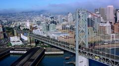 Flying alongside Bay Bridge toward downtown San Francisco. Shot in 2001. Stock Footage