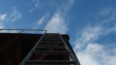 Upward shot of  a man climbing up a ladder Stock Footage
