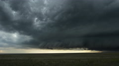 Darkening shelf cloud over prairie landscape, time lapse - stock footage