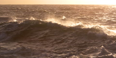 Sepia-toned waves crashing against dark rocks - stock footage