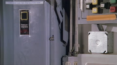 Close-up of hand turning breaker box switch to Off position - stock footage