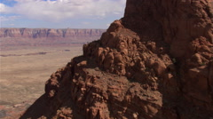 Flying past rock formation in Arizona's Echo Cliffs to wide view Stock Footage
