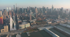 Midtown Manhattan from the air flying down the Hudson river Stock Footage