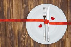Celebrate valentine's day, Heart shape and dishware on a plate Stock Photos