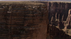 Steep aerial view into canyon, with rushing flight over plateau Stock Footage