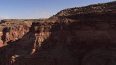 Flight alongside desert cliff Stock Footage