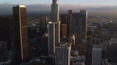 Flying by mid-level floors of skyscrapers in downtown Los Angeles; helicopter Stock Footage