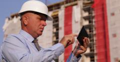 Construction Site Manager Check Digital Plans Uses Tablet Business Building - stock footage