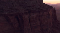 Twilight flight over Eagle Mesa to reveal Monument Valley Stock Footage