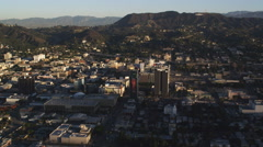 Midlevel flight over Hollywood, sign on hillside in distance. Shot in October Stock Footage