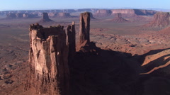 Flying over Stagecoach Butte to Monument Valley vista - stock footage