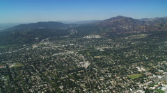 Stock Video Footage of Flying over California's San Fernando Valley toward Mt. Wilson. Shot in October