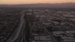 Over the outskirts of Los Angeles in evening light. Shot in October 2010. - stock footage