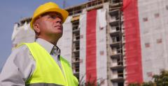 Building Engineer Looking Construction Site Supervise Workers Team Activity Stock Footage