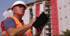 Building Constructor Take Agenda Notes Engineer Supervise Workers Team Activity - stock footage