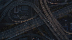 Looking down at a cloverleaf of highway interchanges in Los Angeles. Shot in Stock Footage