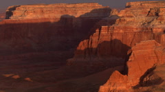 Flying past shadowy red rock cliffs Stock Footage