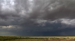 Time-lapse clouds and lightning over prairie horizon Stock Footage