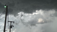 Gray clouds blowing above a rural yard light Stock Footage
