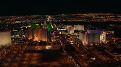 High flight over Flamingo Avenue and Las Vegas casinos at night. Shot in 2005. - stock footage