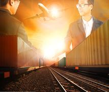 Stock Photo of two business man successful shaking hand with railway logistic and air freigh