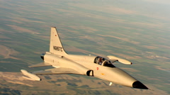 Close air-to-air view of Northrop F-5A in flight Stock Footage