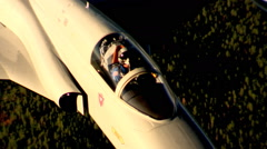 Close overhead view of pilot in cockpit of a Northrop F-5A giving thumbs-up Stock Footage