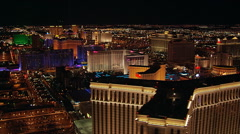 Night flight over Venetian toward the Flamingo in Las Vegas. Shot in 2005. Stock Footage