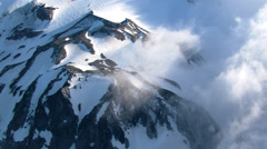 Close orbit of Oregon's Mount Jefferson near summit Stock Footage