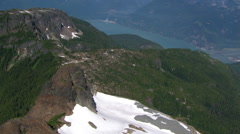 Flight over timbered ridge in Canadian Cascades, British Columbia - stock footage