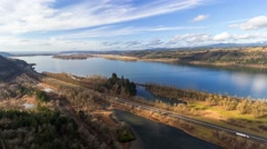 Time Lapse of white clouds over Columbia River Gorge along interstate highway Stock Footage