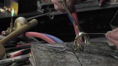 A jeweler creates a bracelet Stock Footage