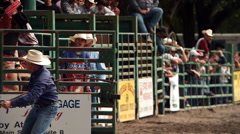 Ultra-slow motion shot of a cowboy riding a bucking bull at a rodeo Stock Footage