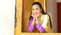 Beautiful Thai woman smiles. Stock Footage