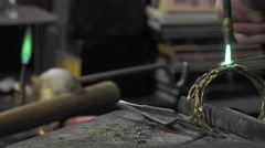 a jeweler creates a bracelet - stock footage