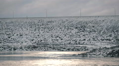 Vehicles driving on top of Dam in Winter. Stock Footage